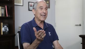 Attorney Lanny Davis speaks during an AP interview in his K Street office in Washington, Thursday, May 3, 2018. (AP Photo/J. Scott Applewhite)