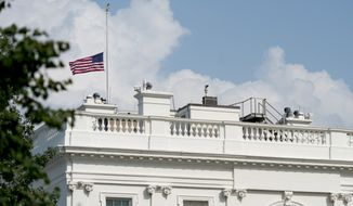 """The American flag files at half-staff at the White House, Monday afternoon, Aug. 27, 2018, in Washington. Two days after Sen. John McCain's death, President Donald Trump says he respects the senator's """"service to our country"""" and has signed a proclamation to fly the U.S. flag at half-staff until his burial. The flag atop the White House flew at half-staff over the weekend but was raised Monday and then lowered again amid criticism. (AP Photo/Andrew Harnik)"""