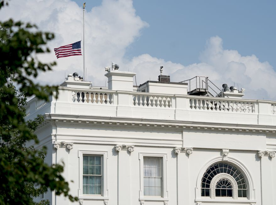 In this file photo, the American flag files at half-staff at the White House, Monday afternoon, Aug. 27, 2018, in Washington. The flag is lowered in times of mourning, including for congressmen who die in office. The flag was lowered on Saturday, July 18, 2020, to mourn the passing of Rep. John Lewis, a hero of the civil rights movement and longtime congressman from Georgia. (AP Photo/Andrew Harnik)  **FILE**