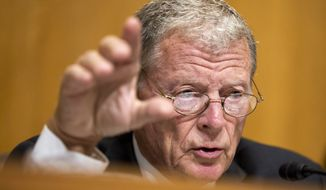 FILE - In this Sept. 29, 2015 file photo, Senate Environment and Public Works Committee Chairman Sen. James Inhofe, R-Okla. speaks on Capitol Hill in Washington. It's something climate negotiators and world leaders try not to talk about publicly: Whatever international deal that comes out of Paris climate talks likely won't be a treaty that needs ratification by a reluctant Republican U.S. Congress.  (AP Photo/Manuel Balce Ceneta, File)