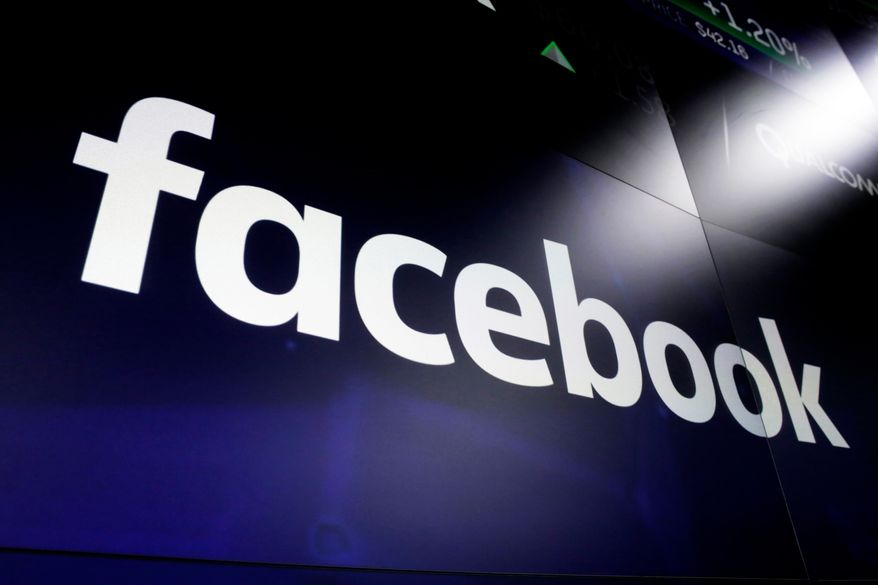 """FILE - In this March 29, 2018, file photo, the logo for Facebook appears on screens at the Nasdaq MarketSite in New York's Times Square. Myanmar's powerful military chief is among 20 individuals and organizations that Facebook says it is banning from its site in order to """"prevent the spread of hate and misinformation."""" The action Monday comes after the social media giant was criticized for being used to inflame ethnic and religious conflict in the country, particularly against Rohingya Muslims. Some 700,000 Rohingya fled their homes in western Myanmar over the past year. (AP Photo/Richard Drew, File)"""