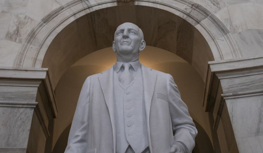 A statue of Sen. Richard Russell of Georgia stands in the rotunda of a Senate office building named after him. After the death of Sen. John McCain this weekend, Senate Minority Leader Charles E. Schumer said he will introduce a resolution to rename the Russell Senate Office Building to honor Mr. McCain. (Associated Press)