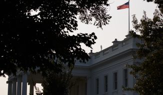 An American flag above the White House flies at full-staff less than 48 hours after the death of Sen. John McCain, Monday, Aug. 27, 2018, in Washington. (AP Photo/Evan Vucci)