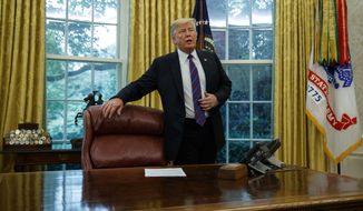 """President Donald Trump arrives for a phone call with Mexican President Enrique Pena Nieto in the Oval Office of the White House, Monday, Aug. 27, 2018, in Washington. Trump is announcing a trade """"understanding"""" with Mexico that could lead to an overhaul of the North American Free Trade Agreement. Trump made the announcement Monday in the Oval Office, with Mexican President Enrique Pena Nieto joining by speakerphone. (AP Photo/Evan Vucci)"""