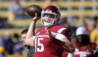 FILE - In this Nov. 11, 2017, file photo, Arkansas quarterback Cole Kelley (15) warms up before an NCAA college football game against LSU in Baton Rouge, La. Kelley will start at quarterback when the Razorbacks open their season against Eastern Illinois on Saturday. First-year Arkansas coach Chad Morris announced the decision to start Kelley on Monday, Aug. 27, 2018, adding that junior Ty Storey will also play. (AP Photo/Gerald Herbert, File)