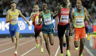 FILE - In this Aug. 6, 2018 file photo Kenya's Kipyegon Bett, second right, runs to the line to win a Men's 800m semifinal during the World Athletics Championships in London. The 800 meters world championships bronze medalist Bett has tested positive for the blood-booster EPO having already been suspended and charged with evading a doping test. He faces a four-year ban. (AP Photo/David J. Phillip, File)
