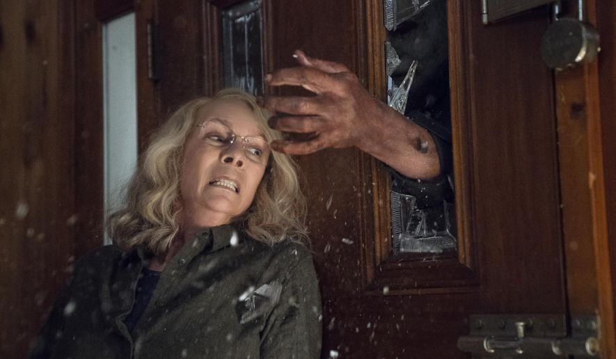 """Jamie Lee Curtis appears in a scene from """"Halloween,"""" in theaters nationwide on Oct. 19. (Ryan Green/Universal Pictures via AP)"""