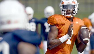 FILE - In this Aug. 14, 2018, file photo, Illinois quarterback AJ Bush (1) throws during NCAA college football training camp in Urbana, Ill.  After an intensive three-man competition, and less than a week before the season opener at home against Kent State, Illinois coach Lovie Smith has picked senior transfer AJ Bush as his starting quarterback. Bush beat out last year's starter and a promising three-star freshman recruit. (Stephen Haas/The News-Gazette via AP, File)