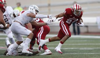 FILE - In this Oct. 29, 2016, file photo, Indiana running back Mike Majette (24) breaks through the Maryland line during the second half of an NCAA college football game in Bloomington, Ind. After suspending Morgan Ellison indefinitely last week, the Indiana Hoosiers are running toward Plan B in Saturday's opener at Florida International. They could go with Cole Gest, their second-leading rusher last season. They could go with Mike Majette, the steady senior. They could go with redshirt senior Ricky Brookins or freshman Stevie Scott. Or they could use all four.  (AP Photo/Sam Riche, File)