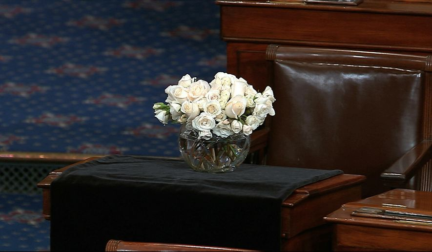 The desk of Sen. John McCain, R-Ariz., is draped in black on the floor of the U.S. Senate on Monday, Aug. 27, 2018, on Capitol Hill in Washington. McCain died at the age of 81, on Aug. 25, 2018, after battling brain cancer. (Senate Television via AP)
