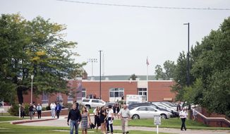 People leave Mollie Tibbetts' funeral at Brooklyn-Guernsey-Malcom High School, Sunday, Aug. 26, 2018, in Brooklyn, Iowa. Cristhian Bahena Rivera is charged with first-degree murder in Tibbetts' death. Authorities have said Tibbetts was abducted while running in July, and an autopsy showed that she died from stab wounds. (Kelsey Kremer/The Des Moines Register via AP)