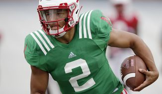 FILE - In this Aug. 8, 2018, file photo, Nebraska quarterback Adrian Martinez (2) runs with the ball during NCAA college football fall practice in Lincoln, Neb. Martinez beat out redshirt freshman Tristan Gebbia for the starter's job and is line to be the first true freshman quarterback to start a season opener in program history. The Cornhuskers open against Akron on Saturday night. (AP Photo/Nati Harnik, File)