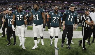 FILE - In this Feb. 4, 2018, file photo, Philadelphia Eagles' Chris Maragos, Brandon Graham, Fletcher Cox, Malcolm Jenkins and Carson Wentz, from left, walk to midfield before the NFL Super Bowl 52 football game against the New England Patriots in Minneapolis. Before they try to become the ninth team to repeat as Super Bowl champions, the Philadelphia Eagles will try to accomplish another tough task. Winning consecutive NFC East titles is so difficult it hasn't happened since the Eagles did it four straight seasons from 2001-04. (AP Photo/Matt Slocum, File)