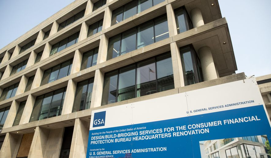 A sign stands at the construction site for the Consumer Financial Protection Bureau's new headquarters in Washington on Aug. 27, 2018. (Associated Press) **FILE**