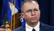 In this July 11, 2018, photo, Mick Mulvaney, acting director of the Consumer Financial Protection Bureau (CFPB), and Director of the Office of Management, listens during a news conference at the Department of Justice in Washington. (Associated Press) **FILE**