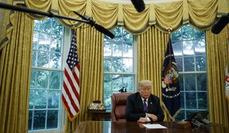 President Donald Trump listens during a phone call with Mexican President Enrique Pena Nieto about a trade agreement between the United States and Mexico, in the Oval Office of the White House, Monday, Aug. 27, 2018, in Washington. (AP Photo/Evan Vucci)
