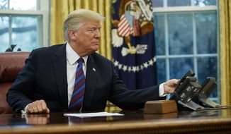 "President Donald Trump hangs up the phone after talking with Mexican President Enrique Pena Nieto, in the Oval Office of the White House, Monday, Aug. 27, 2018, in Washington. Trump is announcing a trade ""understanding"" with Mexico that could lead to an overhaul of the North American Free Trade Agreement.Trump made the announcement Monday in the Oval Office, with Mexican President Enrique Pena Nieto joining by speakerphone.  (AP Photo/Evan Vucci)"