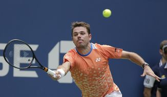 Stan Wawrinka, of Switzerland, returns a shot to Grigor Dimitrov, of Bulgaria, during the first round of the U.S. Open tennis tournament, Monday, Aug. 27, 2018, in New York. (AP Photo/Seth Wenig)