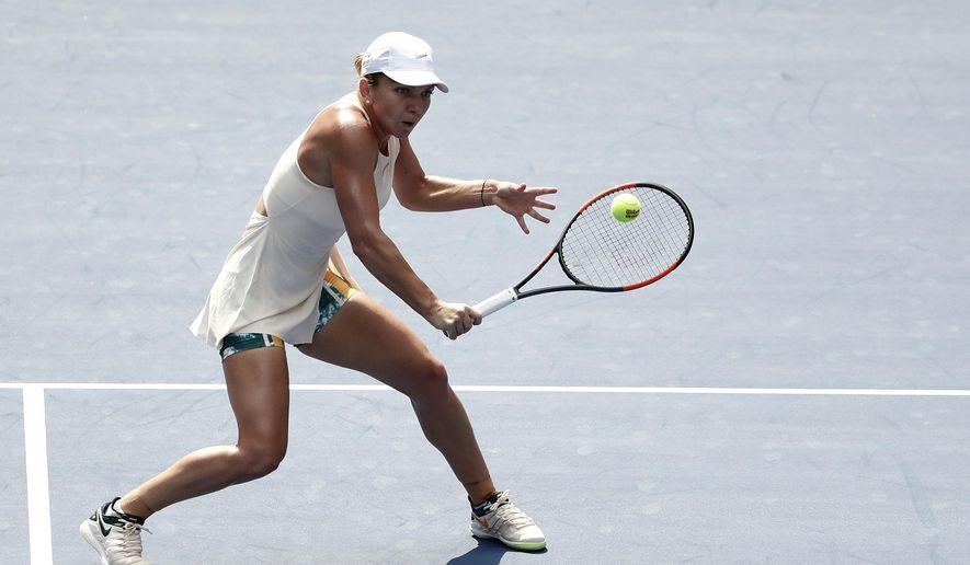 Simona Halep, of Romania, returns a shot to Kaia Kanepi, of Estonia, during the first round of the U.S. Open tennis tournament, Monday, Aug. 27, 2018, in New York. (AP Photo/Andres Kudacki)