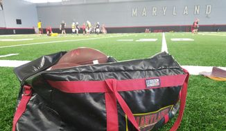 A bag of footballs rests on the sideline of the practice field inside Cole Field House at the University of Maryland as the Terrapins prepare for their 2018 season opener with a practice on Tuesday, Aug. 28, 2018. (Photo by Adam Zielonka / The Washington Times)