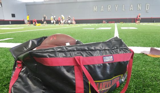 A bag of footballs rests on the sideline of the practice field inside Cole Field House at the University of Maryland as the Terrapins prepare for their 2018 season opener with a practice on Tuesday, Aug. 28, 2018. (Photo by Adam Zielonka / The Washington Times) ** FILE **