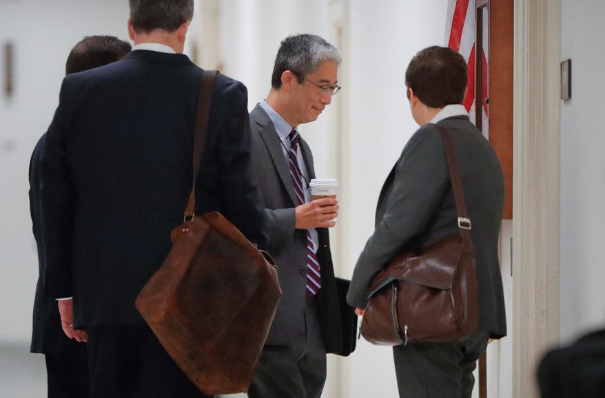 The disclosure is the latest twist in the complicated saga of Justice Department official, Bruce G. Ohr (center), who has close ties to those who created the dossier. (Associated Press)