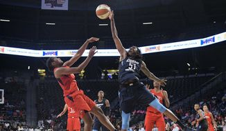 Atlanta Dream forward Jessica Breland (51) blocks a jump shot by Washington Mystics guard Ariel Atkins during the second half of Game 2 of a WNBA semifinals basketball playoff Tuesday, Aug. 28, 2018, in Atlanta. The Dream won 78-75. (AP Photo/John Amis) ** FILE **