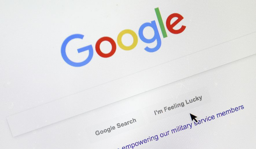 A cursor moves over Google's search engine page on Tuesday, Aug. 28, 2018, in Portland, Ore. Political leanings dont factor into Googles search algorithm. But the authoritativeness of page links the algorithm spits out and the perception of thousands of human raters do. (AP Photo/Don Ryan)