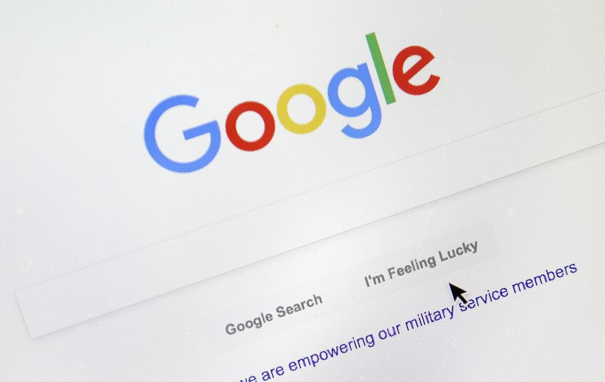A cursor moves over Google's search engine page on Tuesday, Aug. 28, 2018, in Portland, Ore. (AP Photo/Don Ryan) ** FILE **