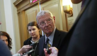 Sen. James Inhofe, R-Okla., stops to speak to members of the media after attending the weekly GOP conference luncheon at the Capitol in Washington, Tuesday, Aug. 28, 2018. (AP Photo/Pablo Martinez Monsivais) ** FILE **