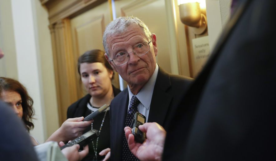 Sen. James Inhofe, R-Okla., stops to speak to members of the media after attending the weekly GOP conference luncheon at the Capitol in Washington, Tuesday, Aug. 28, 2018. (AP Photo/Pablo Martinez Monsivais)