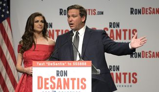 Florida Republican gubernatorial candidate Ron DeSantis, right, speaks to supporters with his wife, Casey, at an election party after winning the Republican primary, Tuesday, Aug. 28, 2018, in Orlando, Fla. (AP Photo/Phelan M. Ebenhack)