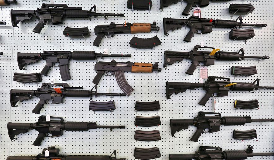 In this July 20, 2014, file photo, guns are displayed for sale by an arms seller east of Colorado Springs, Colo. The U.S. is among wealthy countries where suicides by gun outnumber gun killings, according to a study of 1990-2016 data, released on Tuesday, Aug. 28, 2018. (AP Photo/Brennan Linsley, File)