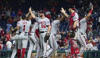 The Washington Nationals celebrate their 5-4 win after the ninth inning of a baseball game against the Philadelphia Phillies, Tuesday, Aug. 28, 2018, in Philadelphia. (AP Photo/Chris Szagola)
