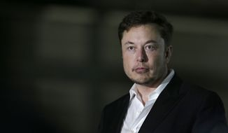 In this June 24, 2018, file photo Tesla CEO and founder of the Boring Company Elon Musk speaks at a news conference in Chicago. While Tesla grapples with internal issues like production delays, a sometimes-erratic CEO and a recent about-face on whether to go private, its rivals are moving aggressively into the luxury electric vehicle space. (AP Photo/Kiichiro Sato, File)