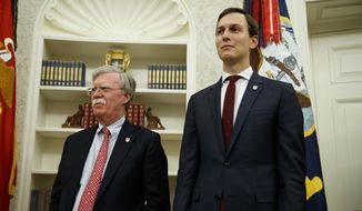 National Security Adviser John Bolton, left, and White House senior adviser Jared Kushner watch as President Donald Trump meets with FIFA president Gianni Infantino and United States Soccer Federation Carlos Cordeiro in the Oval Office of the White House, Tuesday, Aug. 28, 2018, in Washington. (AP Photo/Evan Vucci) ** FILE **