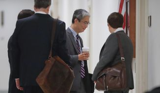 Justice Department official Bruce G. Ohr, center, arrives for a closed hearing of the House Judiciary and House Oversight committees on Capitol Hill in Washington, Tuesday, Aug. 28, 2018. (AP Photo/Pablo Martinez Monsivais) ** FILE **