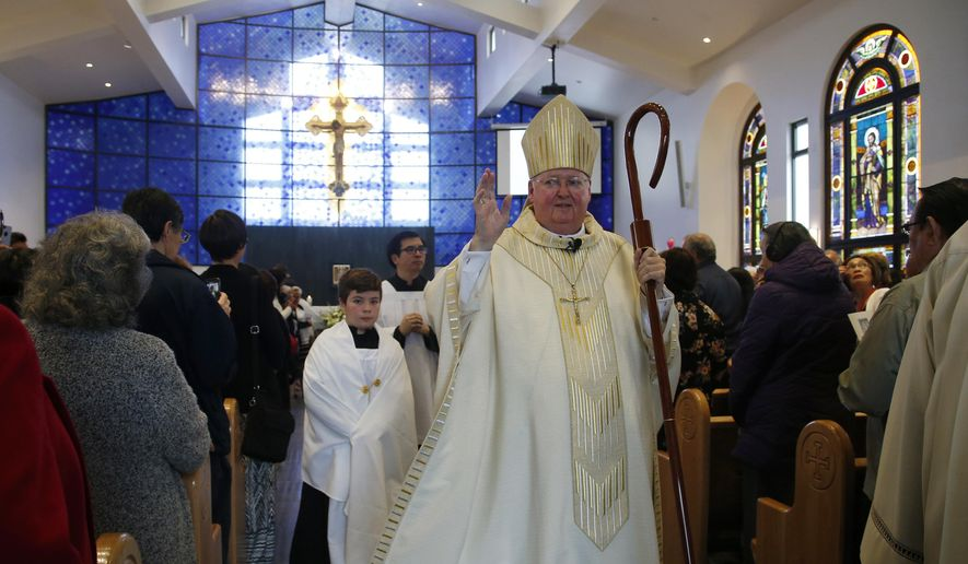 File - In this May 25, 2018, file photo, Bishop Patrick McGrath blesses and dedicates the new Holy Cross Church in San Jose, Calif. The Catholic Diocese of San Jose has purchased a five-bedroom, $2.3 million home in Silicon Valley for its retiring bishop, which is raising some concerns among the diocese's 640,000 Catholics, given the church's mission of charity and serving the poor. (Karl Mondon/Bay Area News Group via AP, File)