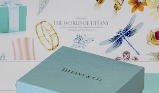 FILE- In this May 22, 2017, file photo, a gift box from Tiffany & Co. is arranged for a photo in front of the Tiffany.com website on a computer in Surfside, Fla. Tiffany and Co. reports financial results on Tuesday, Aug. 28, 2018. (AP Photo/Wilfredo Lee, File)