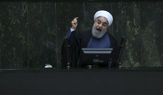 Iranian President Hassan Rouhani speaks in a session of the parliament while answering questions of lawmakers, in Tehran, Iran, Tuesday, Aug. 28, 2018. Rouhani failed to convince parliament on Tuesday that his plans will pull the country out of an economic nosedive worsened by America's withdrawal from the nuclear deal, further isolating his relatively moderate administration amid nationwide anger. (AP Photo/Vahid Salemi)