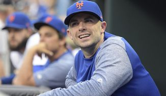 FILE - In this Saturday, June 9, 2018 file photo,New York Mets' David Wright looks on before a baseball game against the New York Yankees in New York. David Wright is moving up to Triple-A to continue his rehab assignment, but the New York Mets say it's unlikely the third baseman will play in the majors this season as he attempts an arduous comeback from back and shoulder injuries. (AP Photo/Bill Kostroun, File)