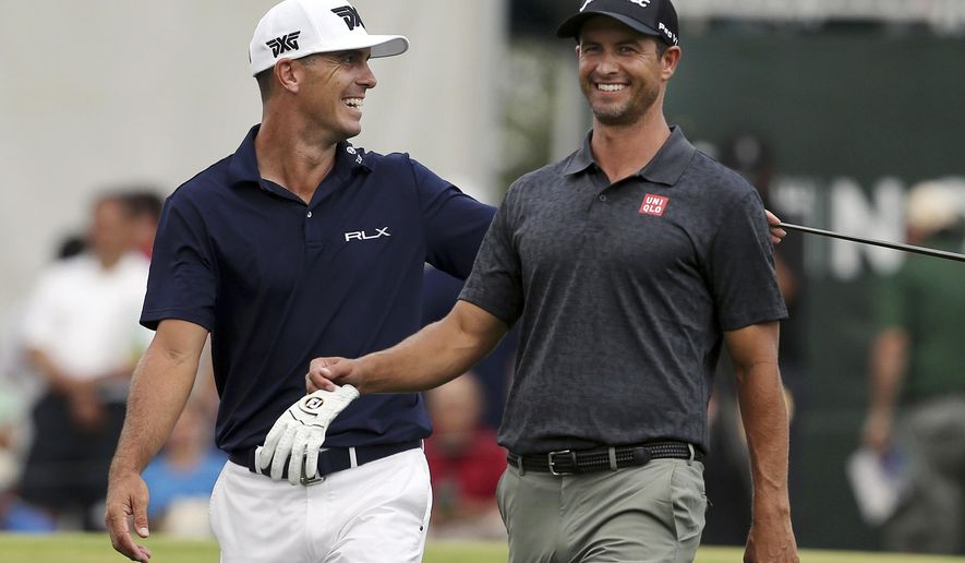 Billy Horschel, left laughs with Adam Scott, of Australia, as they walk on the 17th hole during the final round of the Northern Trust golf tournament Sunday, Aug. 26, 2018, in Paramus, N.J. Bryson DeChambeau won the tournament. (AP Photo/Mel Evans)