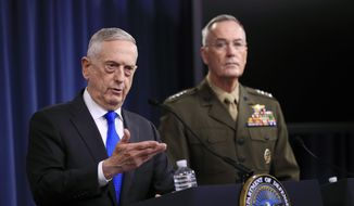 Secretary of Defense Jim Mattis, left, and Chairman of the Joint Chiefs of Staff, Marine Gen. Joseph Dunford speak to reporters during a news conference at the Pentagon, Tuesday, Aug. 28, 2018, in Washington. (AP Photo/Manuel Balce Ceneta) ** FILE **