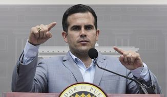 Puerto Rico Gov. Ricardo Rossello speaks during a press conference regarding the number of estimated deaths in the aftermath of Hurricane Maria, in San Juan, Puerto Rico, Tuesday, Aug. 28, 2018. Rossello has raised the island's official death toll from Maria from 64 to 2,975 after an independent study found that the number of people who succumbed after the storm had been severely undercounted. (AP Photo/Carlos Giusti)