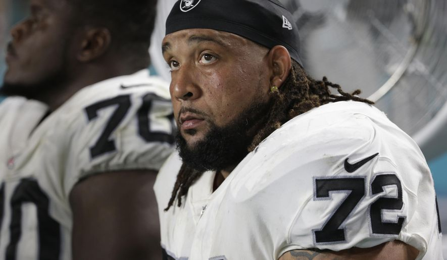 """FILE - In this Nov. 5, 2017, file photo, Oakland Raiders offensive tackle Donald Penn (72) sits on the sidelines during the first half of an NFL football game against the Miami Dolphins,in Miami Gardens, Fla. Penn acknowledged being a big rusty when he got his first game action in more than nine months at an unfamiliar position.He was beaten for a sack on the opening drive for the Raiders and allowed a few other pressures in his first NFL start at right tackle after 170 games and three Pro Bowl selections on the left side. """"I was excited to get out there and try it out live,"""" Penn said.(AP Photo/Lynne Sladky, File)"""