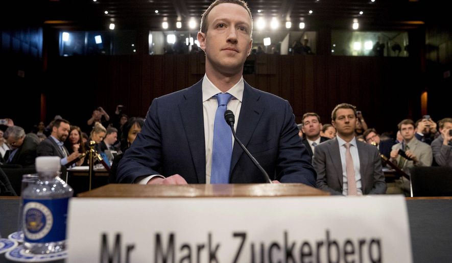 Facebook CEO Mark Zuckerberg testifies before a House Energy and Commerce hearing on April 10, addressing privacy and other issues. (Associated Press)