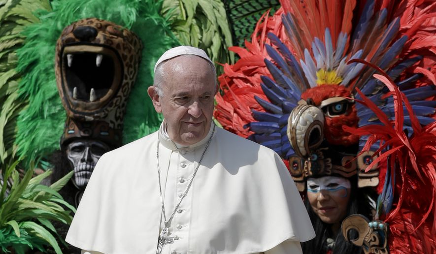 Pope Francis poses for photos with a group from Mexico wearing traditional clothes, during his weekly general audience, at the Vatican, Wednesday, Aug. 29, 2018. (AP Photo/Andrew Medichini)