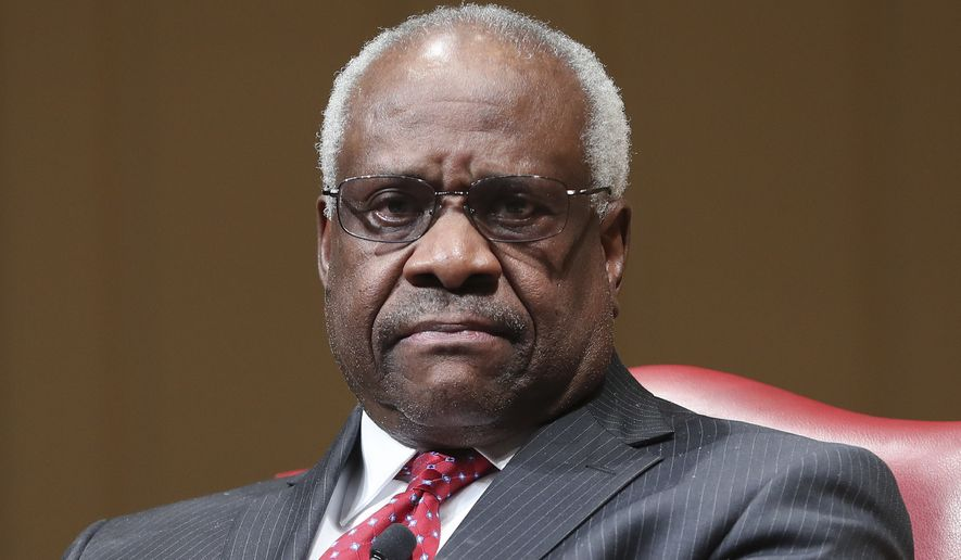 Supreme Court Associate Justice Clarence Thomas sits as he is introduced during an event at the Library of Congress, Thursday, Feb. 15, 2018, in Washington. (AP Photo/Pablo Martinez Monsivais) **FILE**