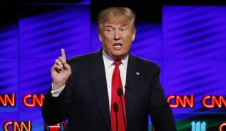 In this Thursday, March 10, 2016, file photo, Republican presidential candidate, businessman Donald Trump, speaks during the Republican presidential debate sponsored by CNN, Salem Media Group and the Washington Times at the University of Miami, in Coral Gables, Fla. (AP Photo/Wilfredo Lee, File)