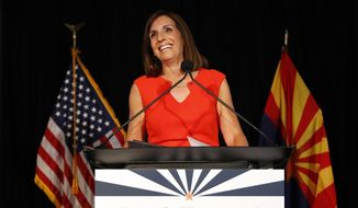 U.S. senatorial candidate and U.S. Rep. Martha McSally, R-Ariz., celebrates her primary election victory, Tuesday, Aug. 28, 2018, in Tempe, Ariz. McSally will face U.S. Rep. Krysten Sinema, D-Ariz., in the November election as they seek the seat of retiring U.S. Sen. Jeff Flake, R-Ariz. (AP Photo/Matt York)